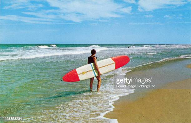 Surfer with Long Board.