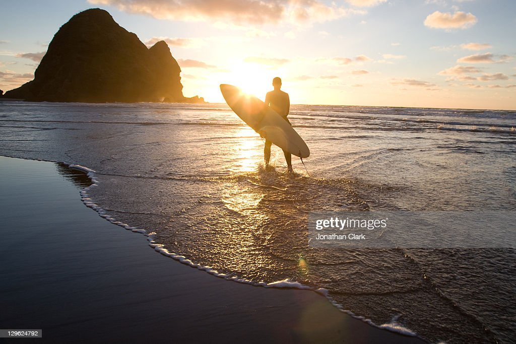 Surfer with surf board : Stock Photo