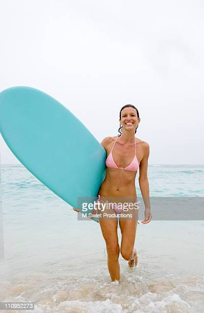 Surfer woman smiling beach