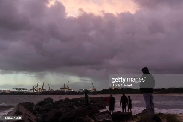 Surfers and families enjoy the rare surf breaking inside Botany Bay on June 04 2019 in Sydney Australia The Bureau of Meteorology issued a severe...