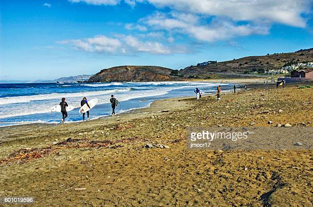 Surfers and Families visit Rockaway Beach near Pacifica