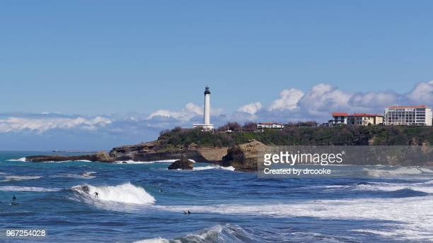 surfers and lighthouse in biarritz - biarritz stock pictures, royalty-free photos & images