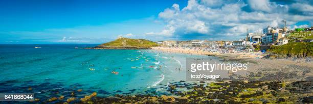 Surfers and sunbathers on sandy beach St Ives panorama Cornwall