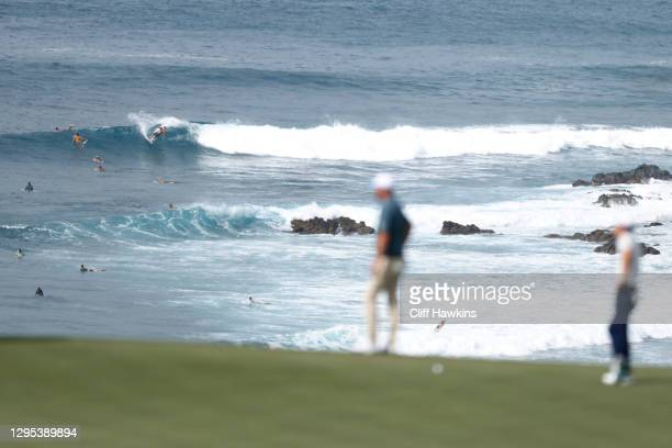 Surfers are seen beyond the 11th green during the second round of the Sentry Tournament Of Champions at the Kapalua Plantation Course on January 08,...
