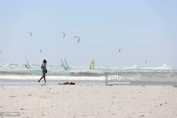 surfers at big bay cape town - wet t shirts stock photos and pictures