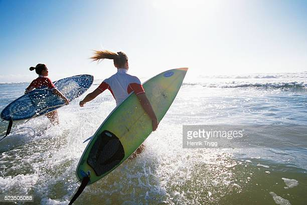 Surfers at Hossegor Beach in France