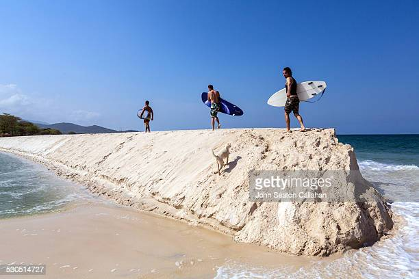 surfers at river number 2 - sierra leone stock pictures, royalty-free photos & images