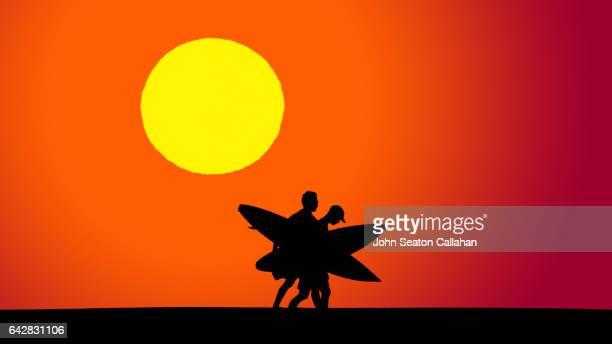 surfers at sunset - agadir photos et images de collection