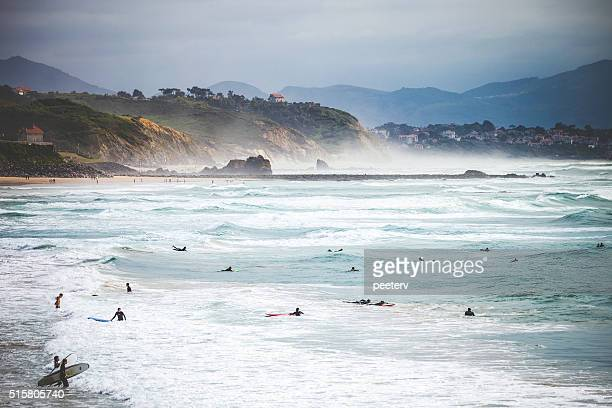 surfers at the beach. biarritz, france. - aquitaine stock photos and pictures