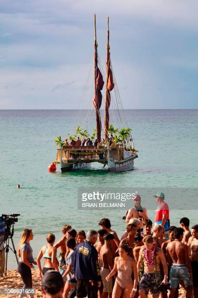 Surfers attend the opening ceremony of the 2018 Eddie Aikau Big wave Invitational Surfing Event at Waimea Bay on the north shore of Oahu in Hawaii on...