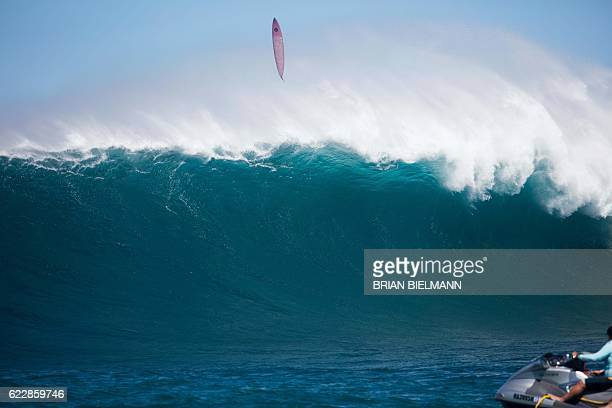 Surfer's board flies in the air after being wiped out by a big wave crashing during the Big Wave surfing Peahi Challenge 2016 at Jaws, off the coast...