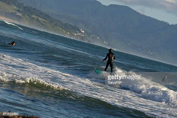 Surfers Cape Kiwanda at Pacific City Oregon Tilted