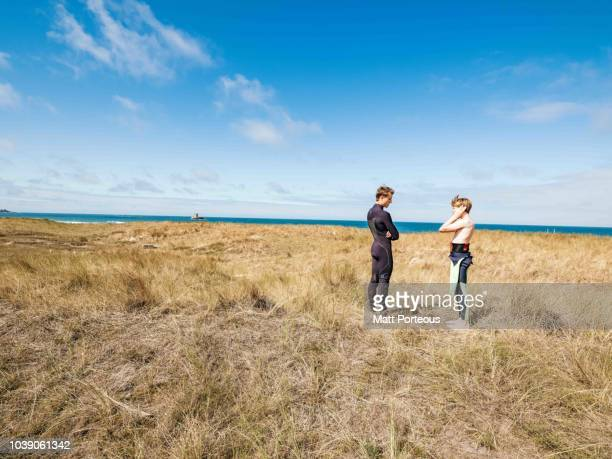Surfers chat amongst the dunes