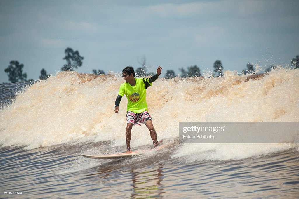 Surfers during bono festival at kampar river in sumatra pictures surfers compete during bono festival at kampar river in teluk meranti village on november 17 junglespirit Image collections