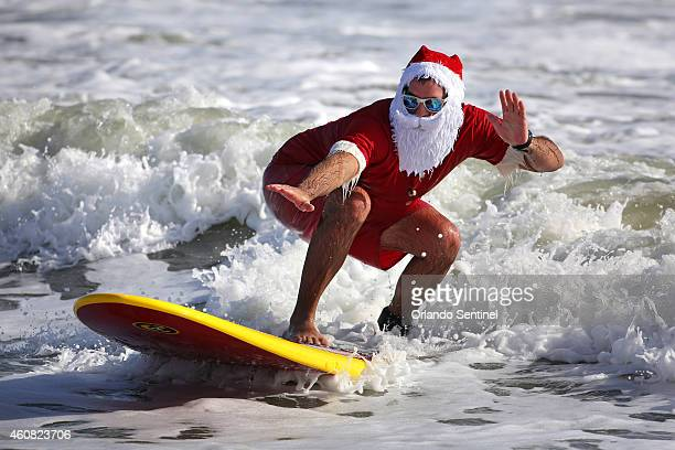 Surfers don Santa outfits during the Surfing Santas of Cocoa Beach fundraiser in Cocoa Beach Fla on Wednesday Dec 24 2014 Hundreds dressed in costume...