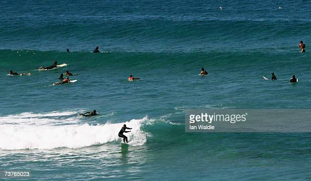 Surfers enjoy the conditions at Bondi Beach despite the beach's closure following a tsunami warning on April 2 2007 in Sydney Australia All of New...