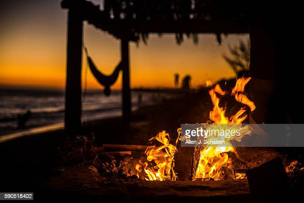 SAN CLEMENT CA TUESDAY AUGUST 16 2016 A surfer's fire pit hammock and palapa at dusk at 'old man's' section of SanO or San Onofre State Beach in San...
