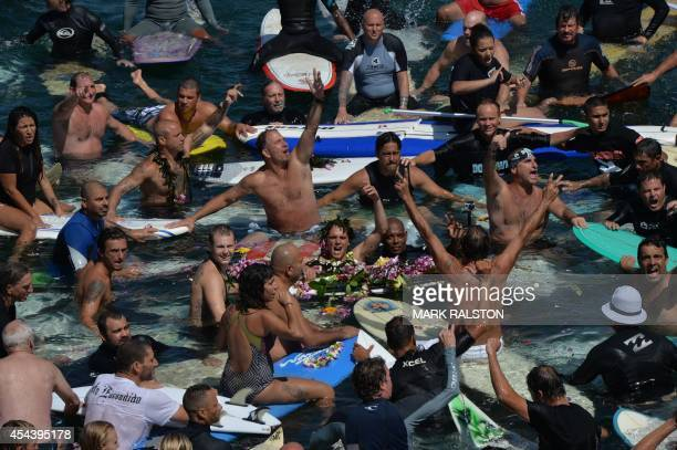 Surfers form a memorial ring during a paddle out as part of the funeral service for the pioneering and legendary skateboarder and surfer Jay Adams...