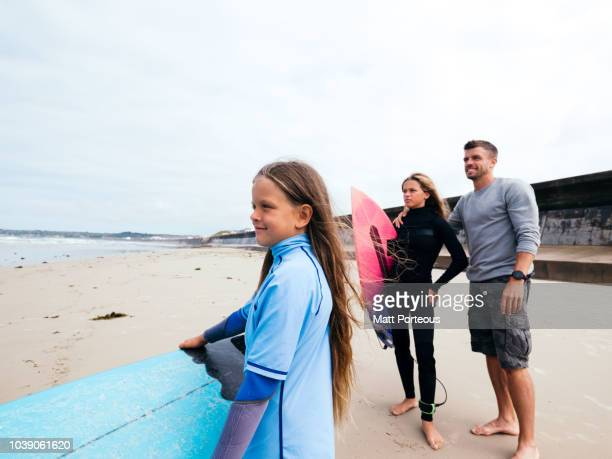 Surfers gaze to the sea