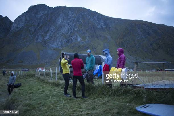 Surfers get ready early in the morning during the Lofoten Masters 2017 the world's most northerly surf competition in Unstad's bay in the arctic...