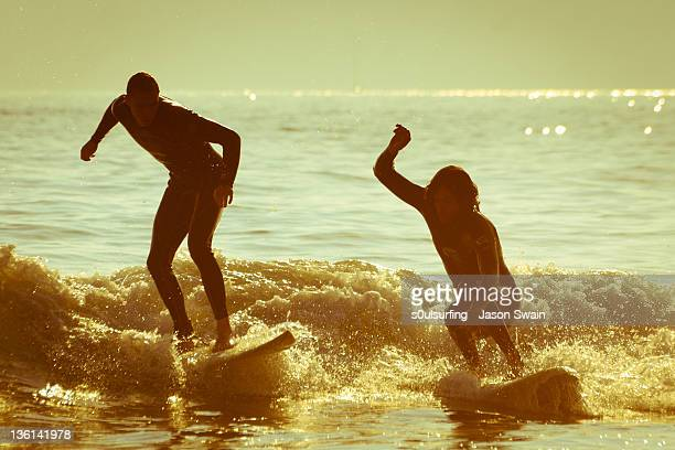 surfers having fun on beach - s0ulsurfing stock pictures, royalty-free photos & images
