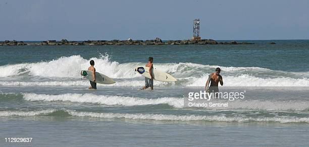 Surfers hit the waves at New Smyrna Beach in Florida