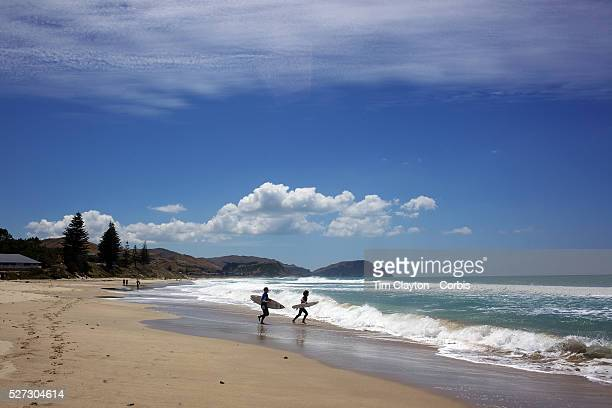 Surfers in action at Wainui Beach near Gisborne Wainui beach is world famous as a surfing beach it's fantastic breaks and it's beautiful stretch of...