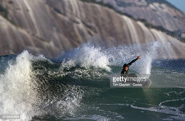 Surfers in action during a big swell in the late afternoon sun at Arpoador Beach near Apoador Point Rio de Janeiro Brazil 18th August 2010 Photo Tim...