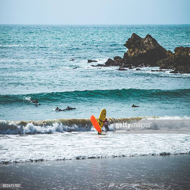 Surfers in action.