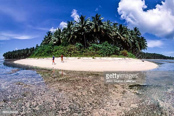 Surfers in the Mentawai Islands