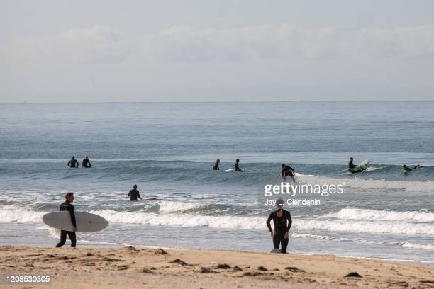 Surfers in Venice Beach as all beaches of Los Angeles county are closed in an effort to slow the spread of the coronavirus March 28 2020