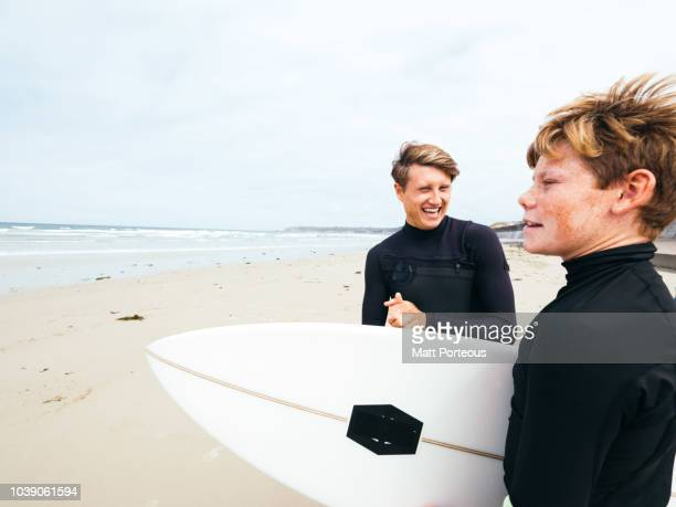 Surfers laugh on beach