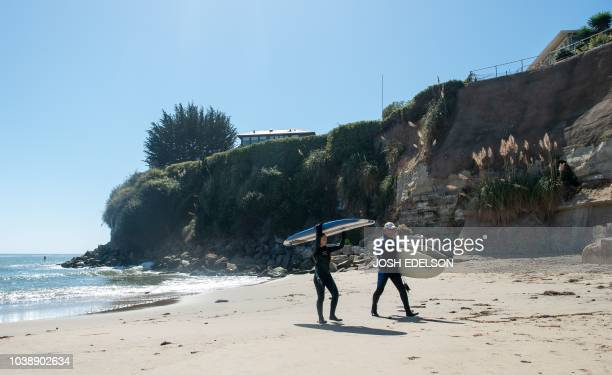 Surfers leave Privates Beach in the Opal Cliffs area of Santa Cruz California on September 19 2018 Local officials charge a $100 annual fee for...