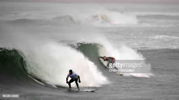 Surfers make the most of the weather after Storm Eleanor recorded winds of up to 90mph on January 3 2018 in Portrush Northern Ireland The Met Office...
