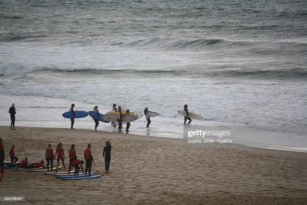Surfers On Beach : Foto stock