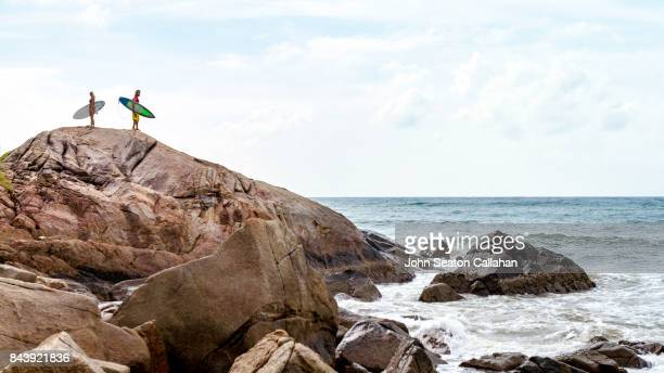 surfers on hainan island - haikou stock pictures, royalty-free photos & images