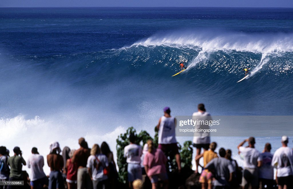 Surfers on North Shore of Waimea Bay, Hawaii Oahu, USA : Stock Photo