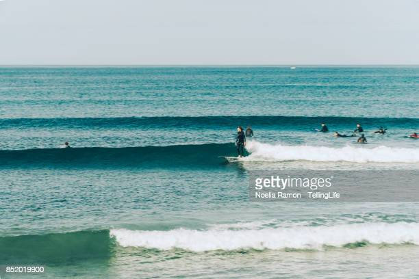 Surfers on the ocean riding waves