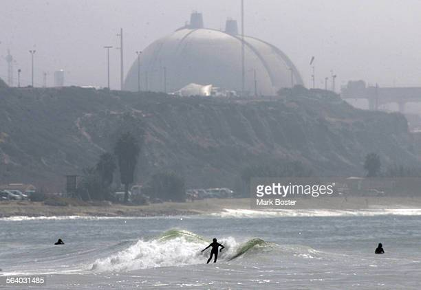 –Surfers on the south end of Trestles enjoy the waves with the San Onofre Nuclear Power Plant in the background The famous surf beach in southern San...