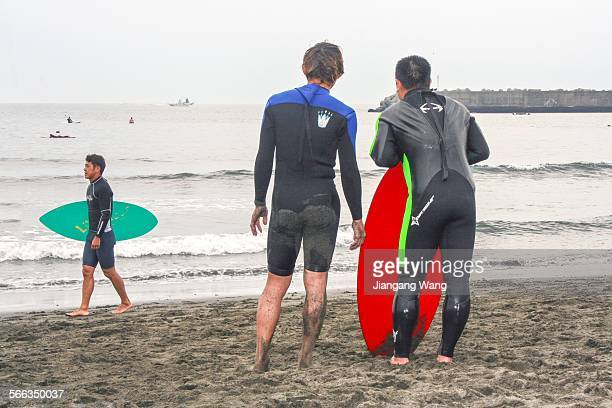 Surfers on the Southern Beach.