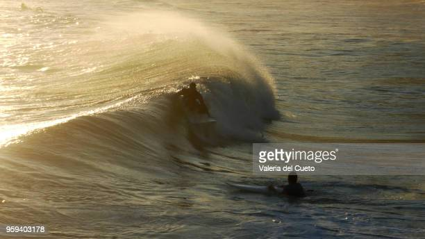 Surfers on the water, meeting in the Ipanema sea