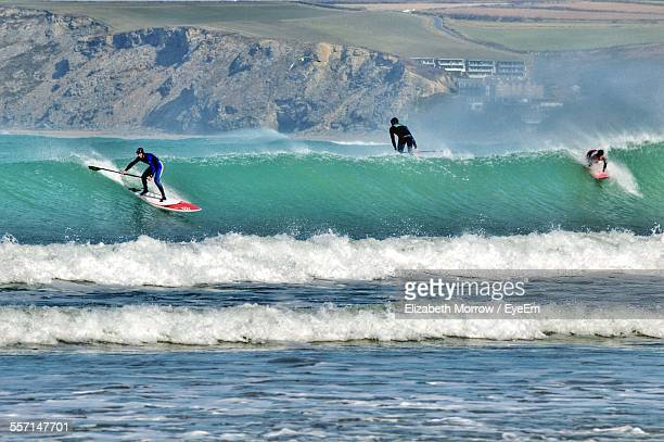 surfers on wave - newquay stock pictures, royalty-free photos & images
