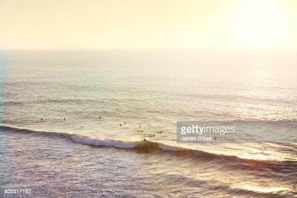 surfers out at sea shot from above, sagres, portugal - sagres bildbanksfoton och bilder