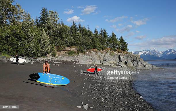 Surfers pack up for the day along the Seward highway after surfing the Bore Tide at Turnagain Arm on July 14 2014 in Anchorage Alaska Alaska's most...