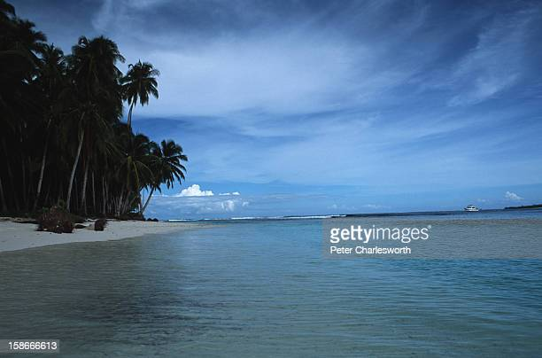 A surfer's paradise One of the thousands of goldensand beaches that ring the Mentawai Islands From the sea these tropical islands can be almost...