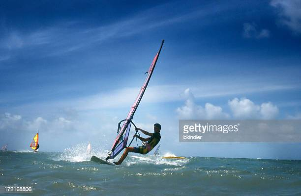 surfers - windsurfing stock pictures, royalty-free photos & images