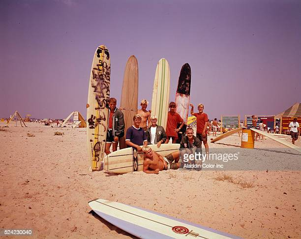 Surfers pose with their surfboards on Virginia Beach