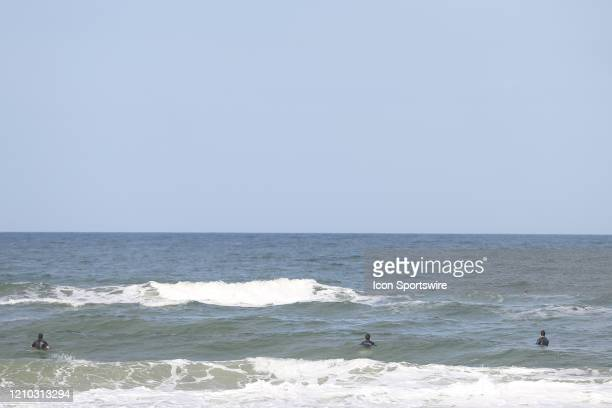Surfers practice social distancing during the beaches first open hour on April 17 2020 in Jacksonville Beach Fl Jacksonville Mayor Lenny Curry opened...