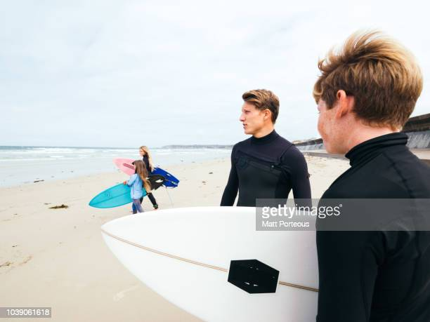 Surfers prepare to enter the sea