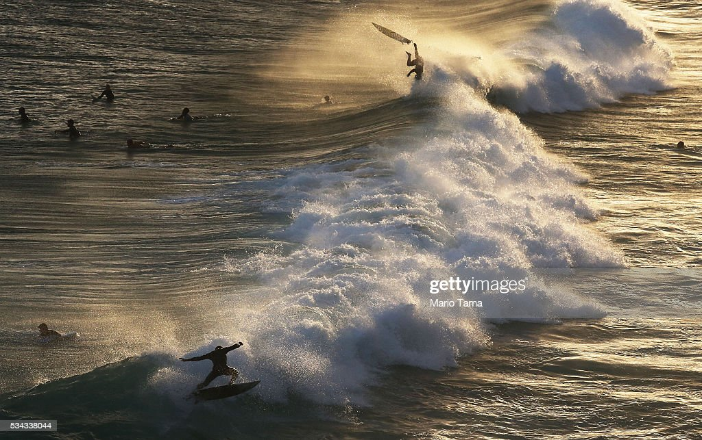 Surfers ride strong waves near Ipanema beach on May 25, 2016 in Rio de Janeiro, Brazil. Polluted water at a professional surf competition last week in Rio's Barra de Tijuca neighborhood highlighted ongoing concerns of the city's polluted waterways ahead of the Rio 2016 Olympic Games. Federal prosecutors announced they are investigating federal funds earmarked to clean up the polluted Guanabara Bay, which will be the site of Olympic sailing events. The bay remains heavily polluted.